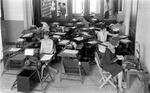 Clerks working on typewriters